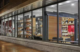 High performance storefront and curtainwall, ACM panel, and windows with custom extrusions.
