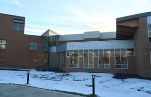 Northern Maine Community College, Presque Isle, Maine: Custom segmented curtainwall, structural sealant glazed curtain wall with custom corner, operable windows, decorative glass.